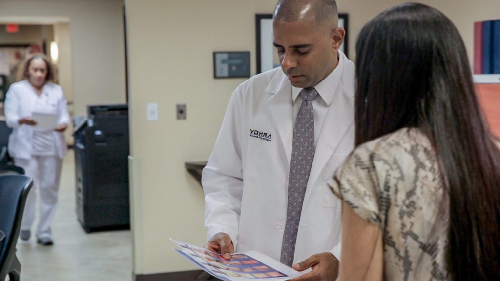 Wound Care Physician Discussing Test Results