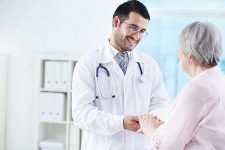 Wound Care Physician Tending to Elderly Patient