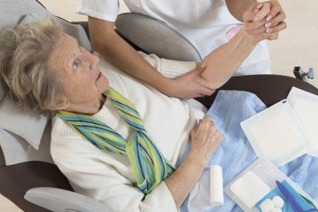 Wound Care Certified Nurse Helping Older Woman