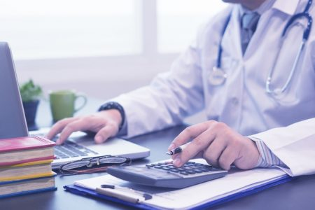 Physician calculating finances