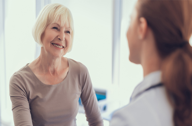 Nurse happily communicating with patient