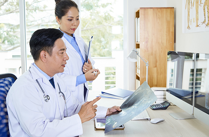 Physician working on patient's report