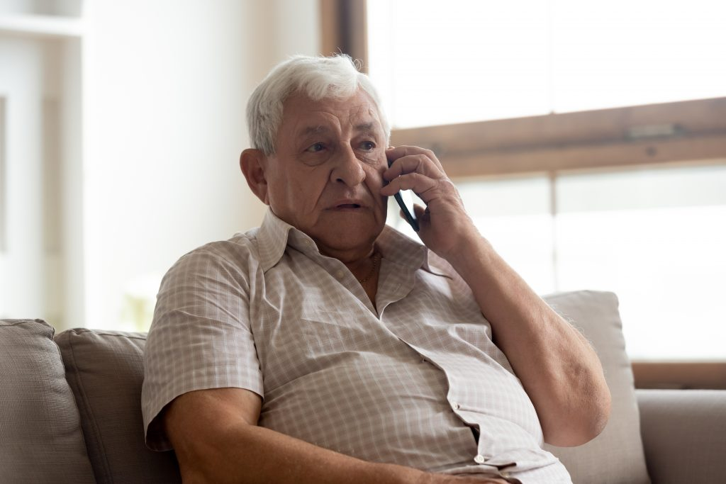 Elderly man talk on phone having distant communication with doctor