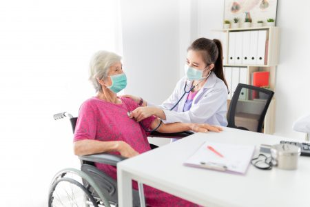 Nurse checking patient