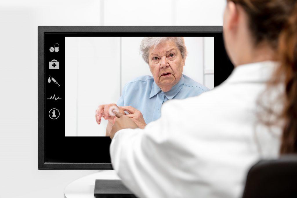 Nurse consulting Patient via Telehealth during COVID-19