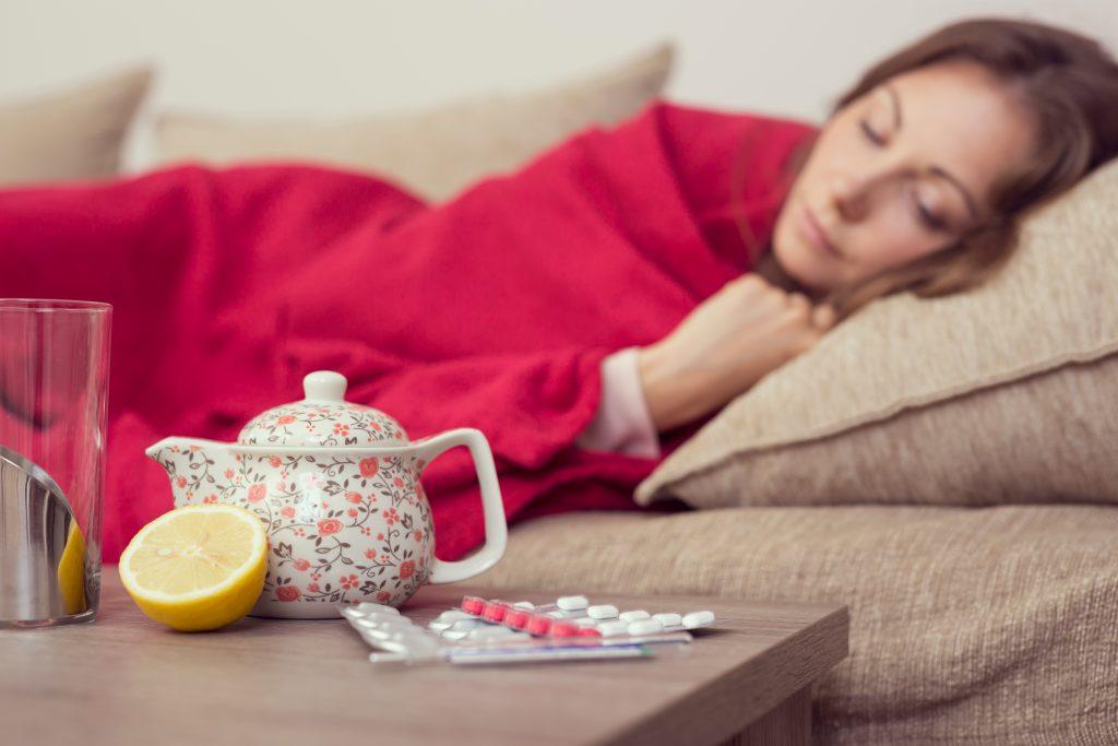 Sick woman sleeping on bed