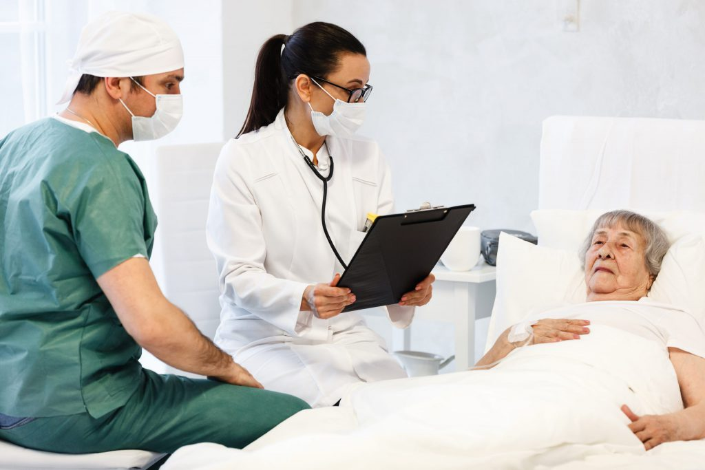 Doctor and Nurse checking Patient's report