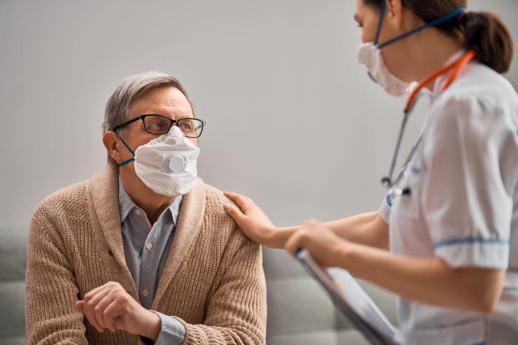 Nurse Communicating with patient