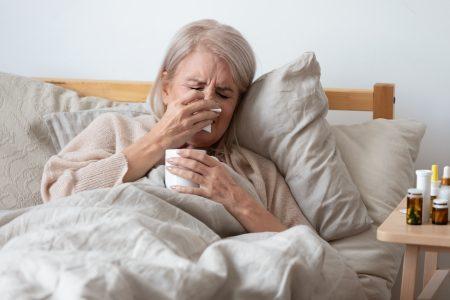 women suffering from flu