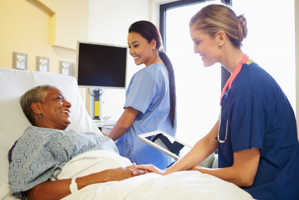 Nurses happily communicating with patient