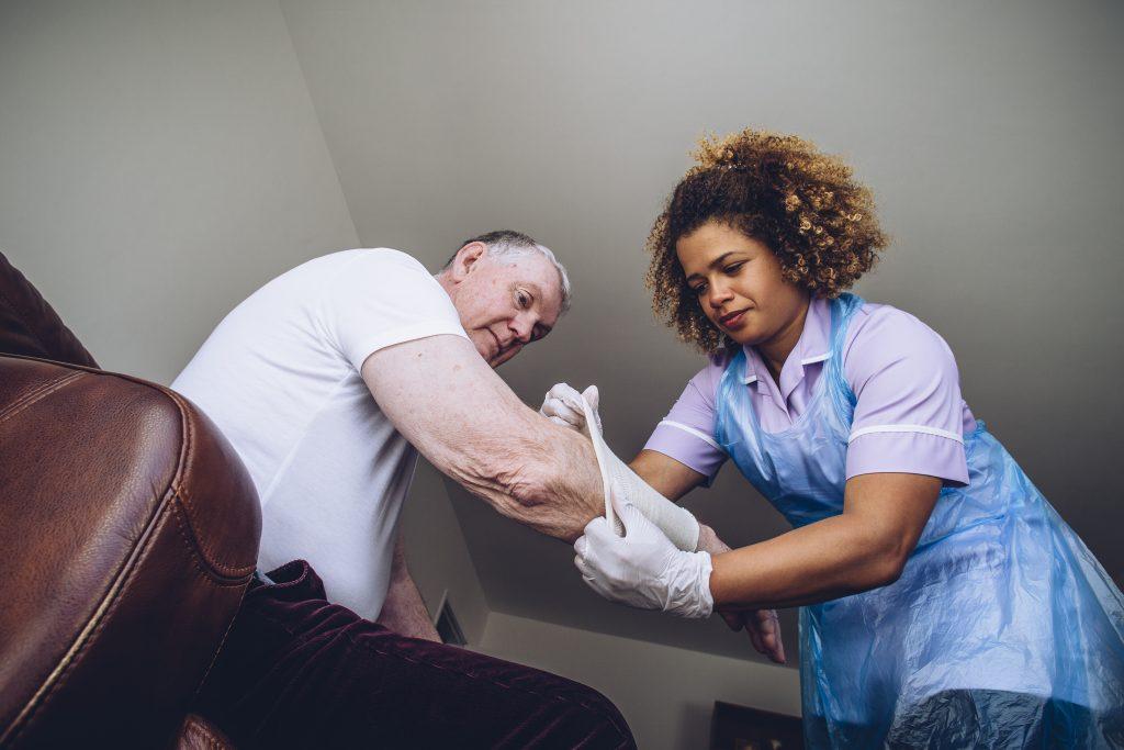 Nurse Applying Compression Wraps