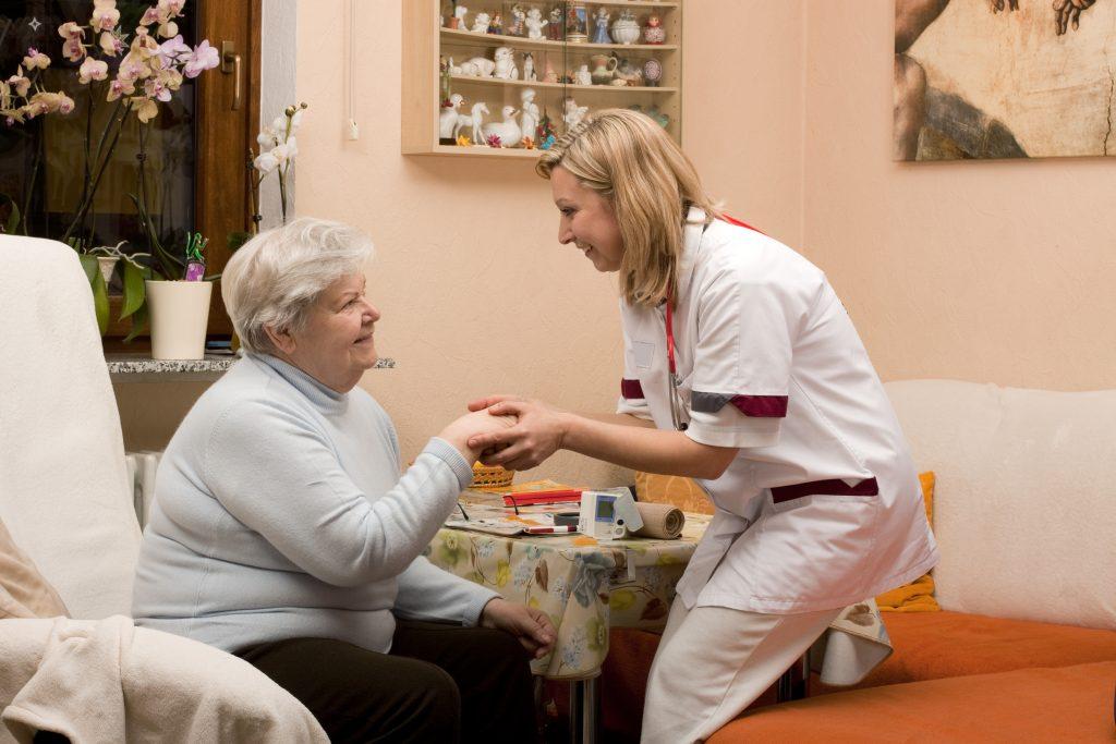 Wound Care nurse Tending to Elderly Patient