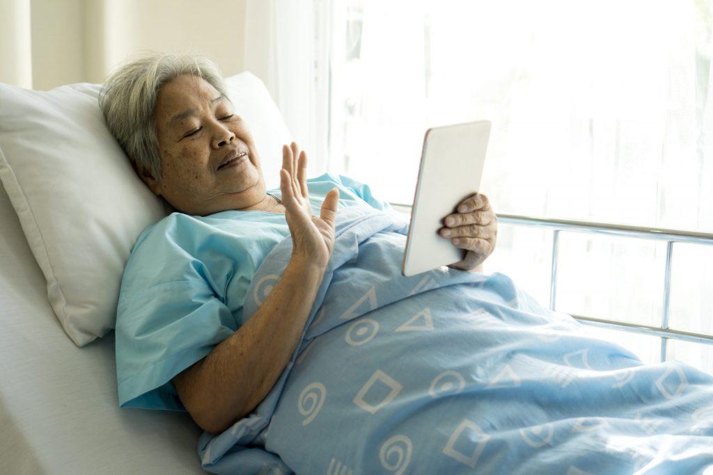 Elderly patient using digital tablet