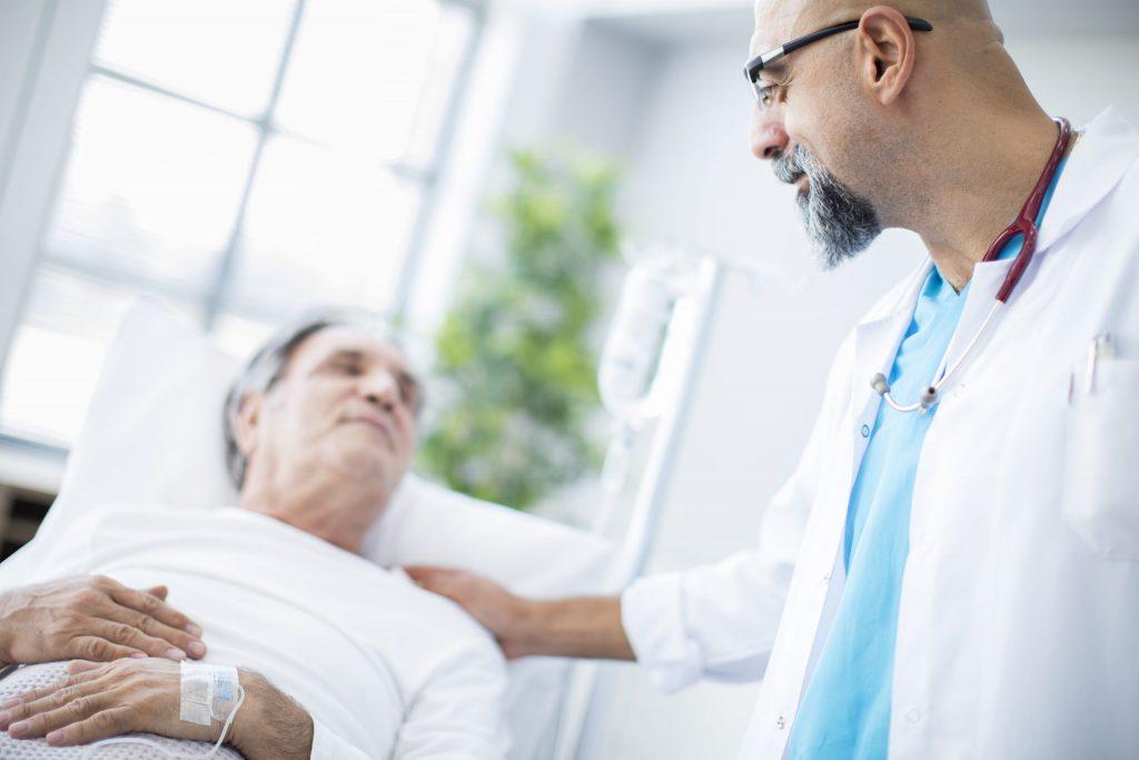 Male Nurse Taking Care of Elderly Patient