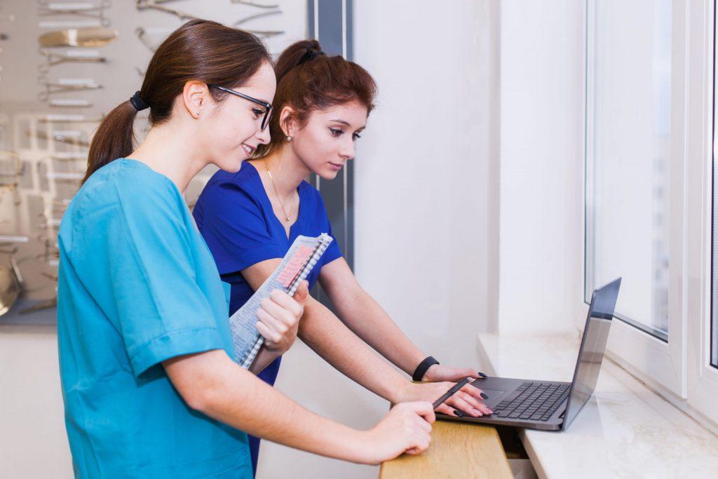 Young Nurses checking Laptop