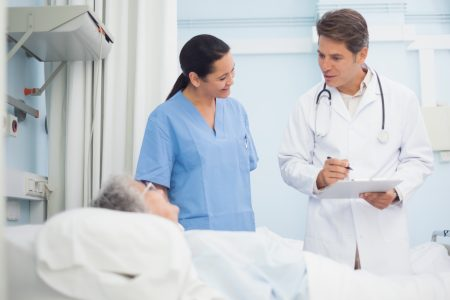 Doctor and Nurse Communicating with Patient
