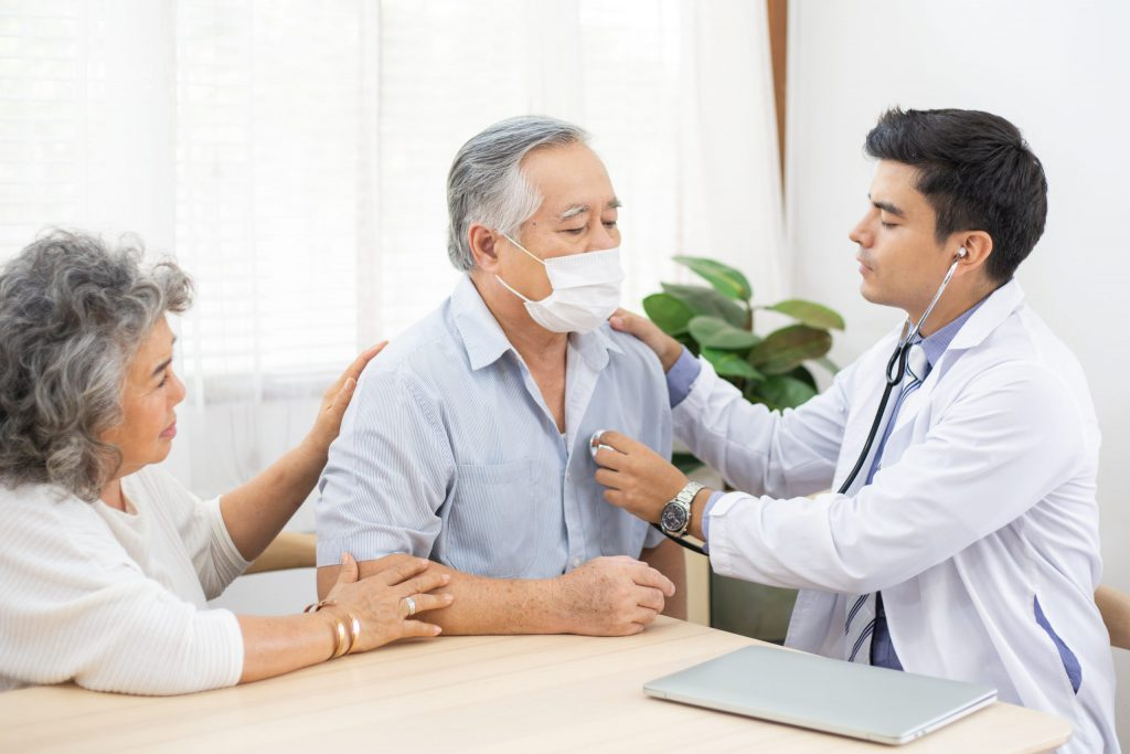 Physician checking Patient with Medical Stethoscope