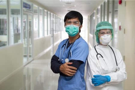 Physicians Wearing Mask and Standing in Hospital