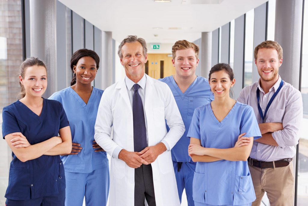 Group of Doctors and Nurses standing in Hospital