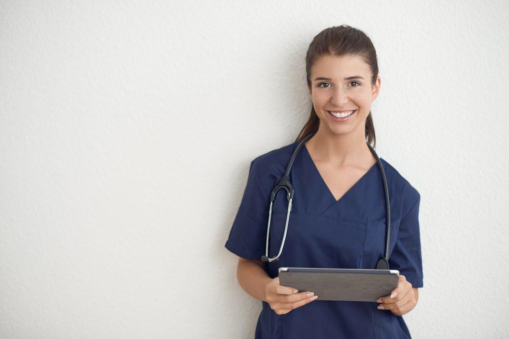 Nurse checking digital tablet