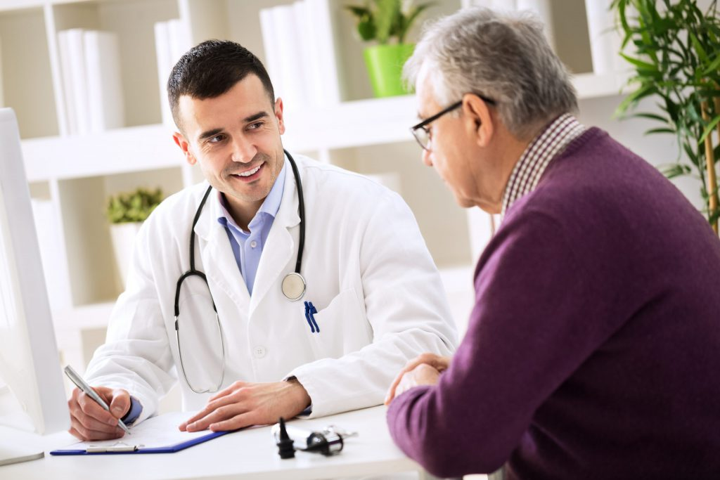 Physician explain something to patient