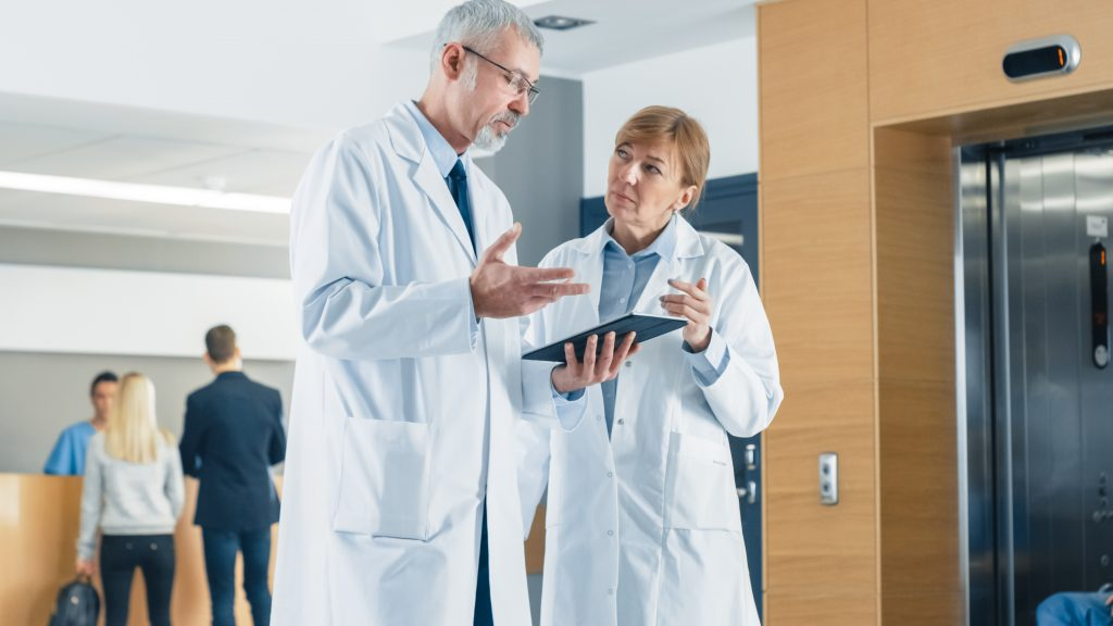 Physician checking patient's report