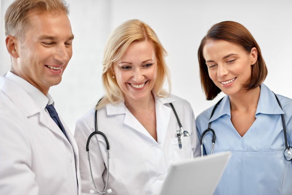 Medical Staff checking Digital Tablet
