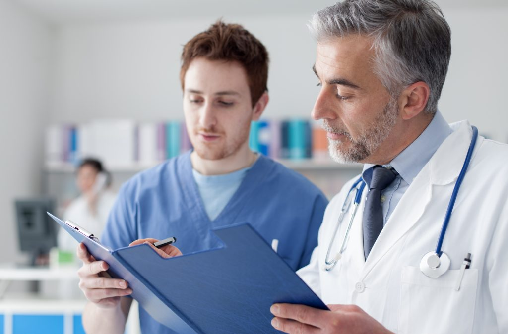 Physicians Discussing Medical Patient Records