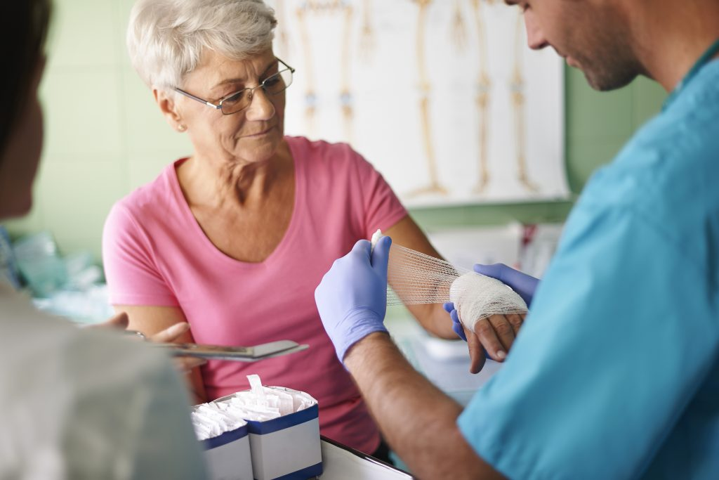 Senior Woman with Hand Bandage