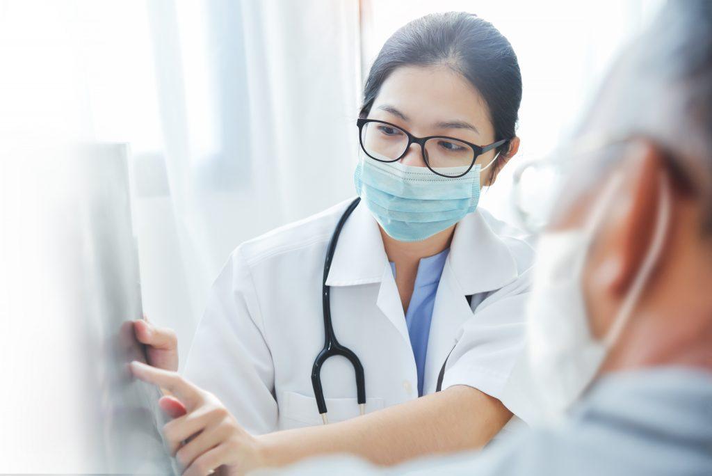 Female Doctor Attending Elderly Patient