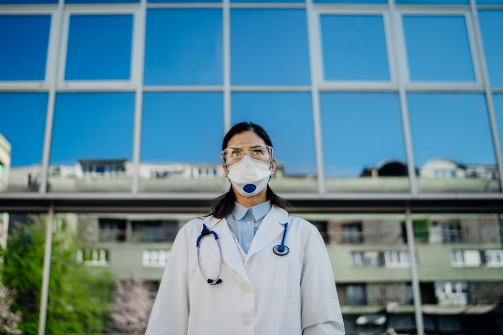 Female physician in Front of the Isolation Hospital