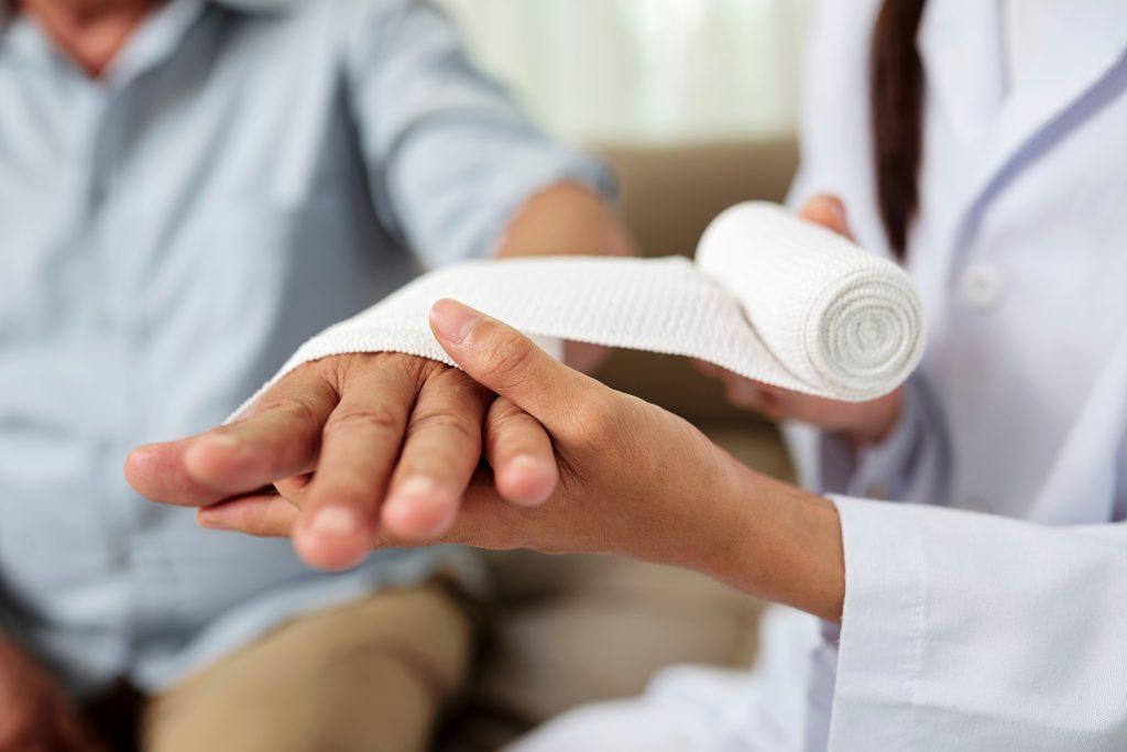 Senior man Hand Bandage