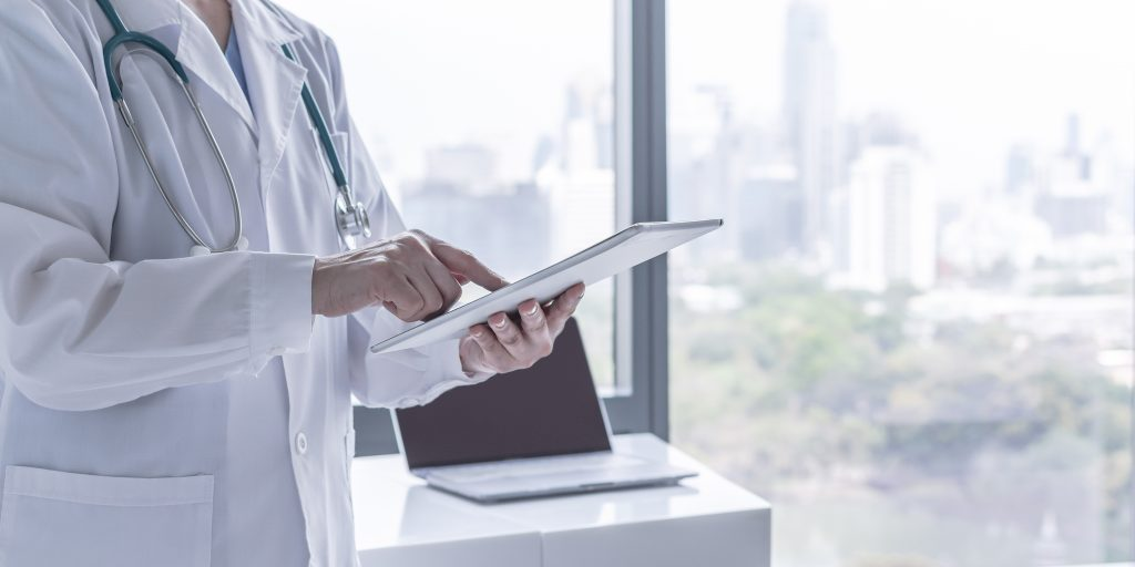 Physician checking Digital Tablet