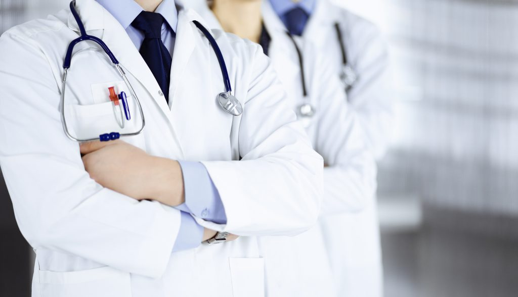 Doctors with Stethoscopes in Hospital
