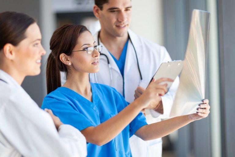 Doctor And Nurse Examining X-ray