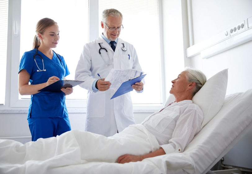 physician and nurse checking patient